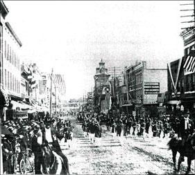 A parade on the 300 block of South Elm Street circa 1900